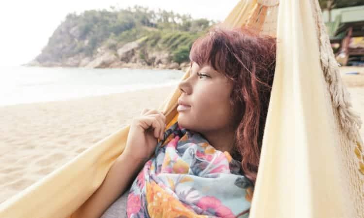 Beautiful Woman Enjoys View from Hammock on Tropical Thailand Beach