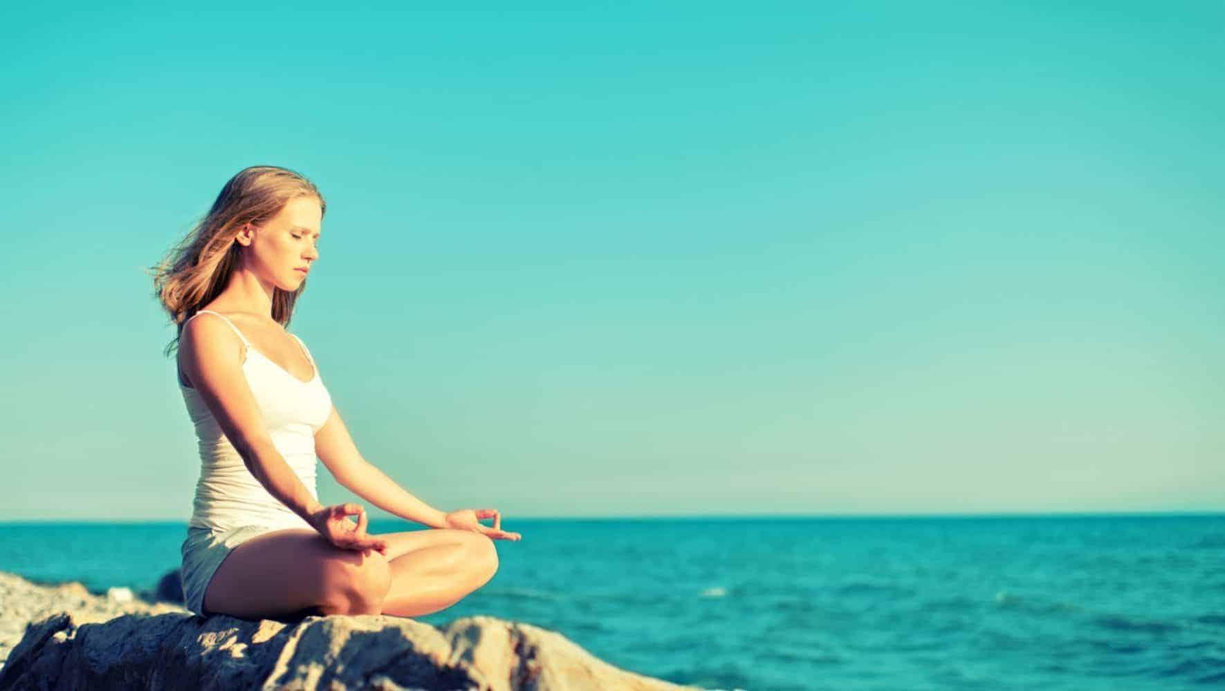 Woman Meditating at Sea